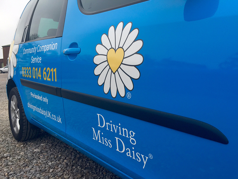 Close up, Driving Miss Daisy, complete Arlon Xp6000 printed laminated wrap with cut vinyl text