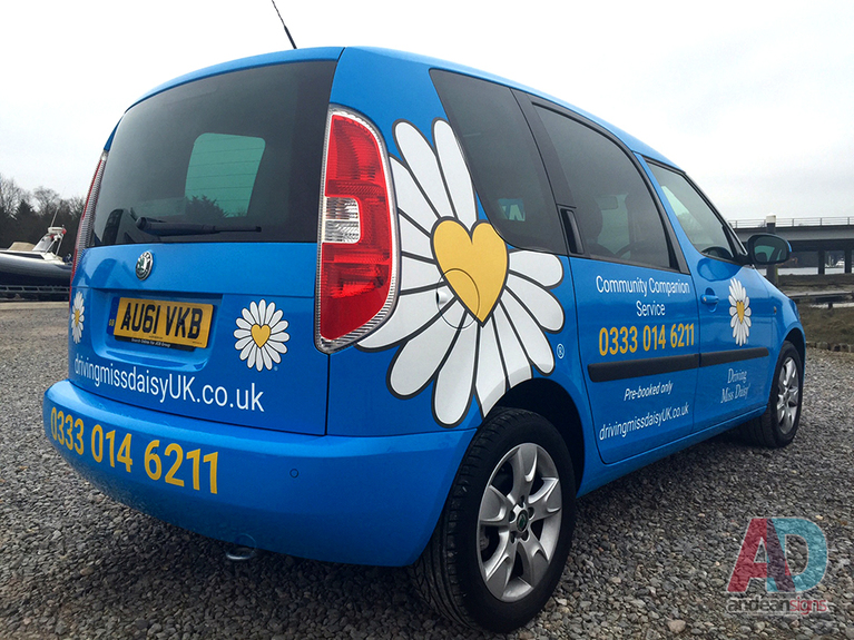 Driving Miss Daisy,  printed laminated wrap, with cut vinyl text